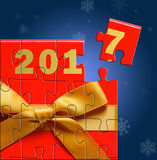 New Year 2017 background with gift box puzzle Stock Images