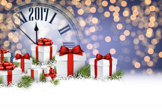 2017 New Year background with gifts. 2017 New Year background with clock and gifts. Vector illustration Royalty Free Stock Image