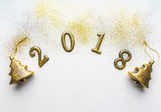 2018 new year background with glitter, sparkles, serpentine on white. Top view, close-up. Festive greeting card with copy spase. Royalty Free Stock Photos