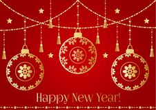 A New year background with golden christmas balls, tassel, star light   Royalty Free Stock Images