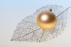 New Year background with golden glass toy Royalty Free Stock Photo