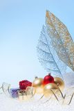 New Year background with golden glass toys Royalty Free Stock Images