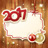 New Year background with label, baubles and text Stock Image