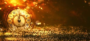 New Year Background. Clock countdown. golden Holiday abstract defocused Background With glowing Stars. Blurred Bokeh. Blurred background Royalty Free Stock Photography