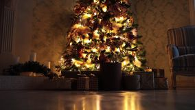 New year background with presents and flashing garland on the tree. Presents under New Year tree with flashing garland background stock video footage