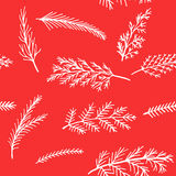 New Year  background seamless pattern of white snow spruce twigs on a red background Stock Image