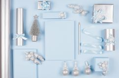 New Year background - set of different decorations, gift boxes, christmas tree, blank wish list paper in soft pastel blue. stock image