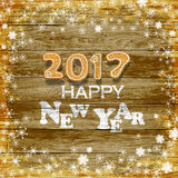New Year 2017 Background, Snowflakes on a wooden background Royalty Free Stock Images