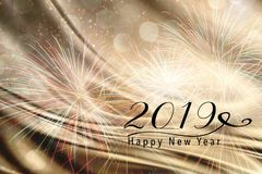 2019 New Year background for Social media. Fireworks on a gold and silver abstract backdrop with silk fabric. Happy New Year 2019 quote. Perfect for social media Stock Images