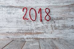 New Year 2018 background on a wooden surface with shiny numbers stock images