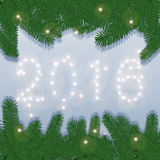 New Year Background for your Party invitations. Spruce branches and figures 2016 of flares. Stock Photos