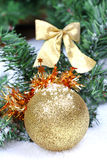 New year ball on firtree branch. In snow Royalty Free Stock Photography