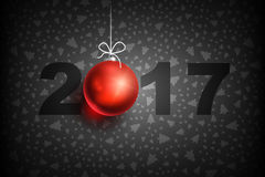 New year 2017 ball-01. Happy New Year 2017 on dark background. Christmas related ornaments objects on color background. Greeting Card Ready for your design Stock Photos