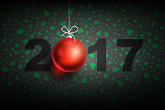 New year 2017 ball2-01. Happy New Year 2017 on dark background. Christmas related ornaments objects on color background. Greeting Card Ready for your design Royalty Free Stock Photography