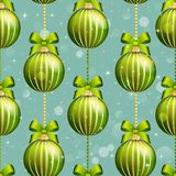 New Year ball pattern. Christmas wallpaper with bow and ribbon. Royalty Free Stock Photography