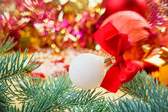 New Year ball with red bow Royalty Free Stock Image