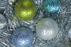 New Year ball in tinsel and spangles. Royalty Free Stock Photo