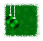 Christmas Baubles in Frozen Frame with Snowflakes on Green Royalty Free Stock Images
