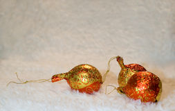 The New year balls. The New year red-yellow small balls on the fur background Royalty Free Stock Photo