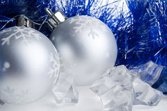 New year balls, tinsel and ice cubes Royalty Free Stock Photo