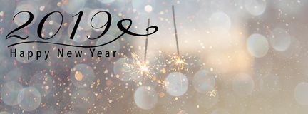 2019 New Year Banner header for Social media. Sparklers against a pink background with bokeh and falling snow effect. Happy New Year 2019 quote. Panoramic banner Stock Images