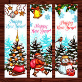 New Year banners on wooden background. New Year winter holidays banners on wooden background. Santa Claus, snowman and pine tree with gift box and presents Royalty Free Stock Images