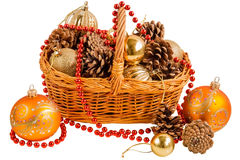 New year basket with pine cones and Christmas decorations Stock Photos