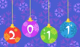 New year baubles over snowflakes Royalty Free Stock Photography