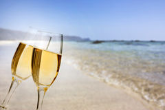 New Year at the beach. Glasses of champagne on the beach against the sky and blue sea Royalty Free Stock Photos