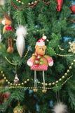 New Year. Bear on holiday tree Stock Photos