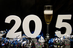 New year 2015 on black with confetti and champagne. New year 2015 on black with blue and black ribbon and confetti Stock Image