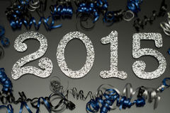 New year 2015 on black with confetti and champagne. New year and graduation 2015 on black with blue and black ribbon and confetti Stock Image