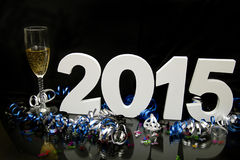 New year 2015 on black with confetti and champagne Stock Photo