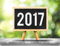 2017 new year on blackboard on plank white wood with green abstr. Act blur tree background,Ecology Business concept Royalty Free Stock Image