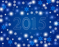 New Year 2015 on a blue background. With snowflakes Royalty Free Stock Photography