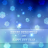 New year blue blurred background with snowflakes with text Marry Christmas And Happy New Year Royalty Free Stock Image