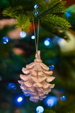 New Year bokeh cone. New Year  toy on the new year tree Royalty Free Stock Photo