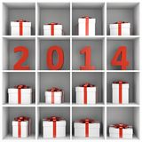 2014 New Year book shelf with gift boxes. 2014 new year concept. Red number characters and gift boxes placed on white square book shelf Royalty Free Stock Image