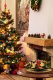 New Year bouquet on Christmas tree and fireplace defocused background stock photo