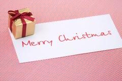 New Year box with a congratulatory card Stock Photos