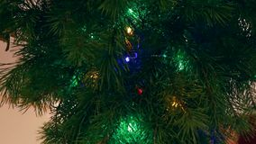New year, a branch of pine garlands wink stock footage