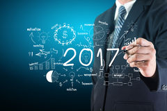 2017 new year business success. Businessman creative thinking drawing charts and graphs strategy plan ideas Stock Images
