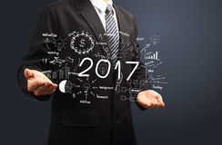 2017 new year business success in hands. Inspiration creative thinking drawing charts and graphs analysis and planning, consulting, team work, project Stock Photo