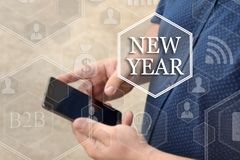 New Year, button on the touch screen with a blur background of t royalty free stock photography