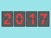 New year 2017 came. With coming happy New Year 2017 mechanical scoreboard congratulation, flip symbol on blue background. New year, happy and christmas concept Stock Illustration
