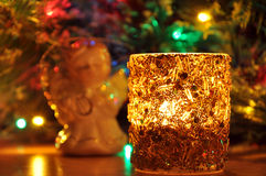 New-year candle and fir-tree toy Stock Images