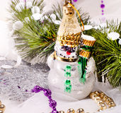 New year card with beautiful snowman. And fur tree branch Royalty Free Stock Photos