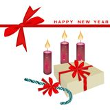 New Year Card with Candle and Gift Boxes Royalty Free Stock Photos