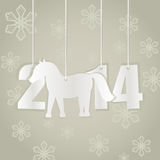 New 2014 year card. With cut paper figures and horse shape Royalty Free Stock Photos