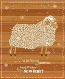 2015 new year card with cute sheep. Chinese Goat. Vector illustration. Snowflakes on winter background Royalty Free Stock Images